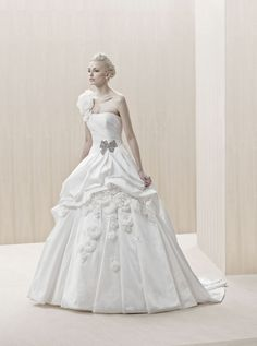 """""""Elorza"""" silk ball gown wedding dress with a beaded bow detail at the waist and three-dimensional floral accents on the skirt, Blue By Enzoani"""