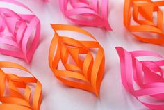 These pink and orange traditional paper ornaments will modernize your Christmas tree! Pink Pad - the app for women - pinkp.ad