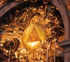 Tetragrammaton St Peter's Basilica Vatican City Italy; It is barely visible in gold, but note the trinitarian symbol, the triad. The trinity is not a Bible teaching. It was adopted by the Church in the 4th Century, A.D. and opposed by a those who wanted no deviation from scripture.