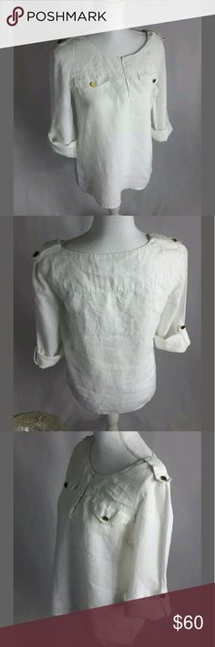 """Tory Burch White Linen Tunic Top Sleeves Size 6 Tory Burch   SIZE:  6  COLOR:  White   EXCELLENT PRE-OWNED CONDITION   MEASUREMENTS (laying garment flat) BUST (armpit to armpit) : 19"""" LENGTH:  24"""" WAIST: 19"""" SLEEVE LENGTH (from shoulder seam to bottom arm): 23 DETAILS:     White Linen Tunic Top  Sleeves are full length with option to fold up with button hold Tory Burch printed Gold Buttons on sleeves, front """"pockets"""" and shoulder with fabric hold Has 2 faux pockets in front on chest 4 hooked…"""