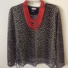 Leopard Print Zoey Beth Shirt 100% Polyester shirt with drawstring sides accentuates any body perfectly. Leave them loose or tie for a more polished look. Paired with an accessory pop this top will turn heads! This top is 2X, but fits more like an XL. Zoey Beth Tops Blouses