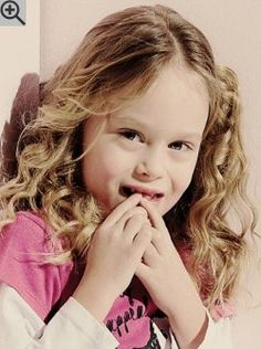 Long hairstyle for little girls with natural curls. The length allows a lot of different styles and braiding.