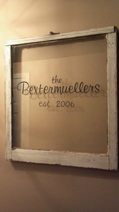 My first DIY!! Old window frame w/our last name hand painted & the year we got married. Hanging in our entryway
