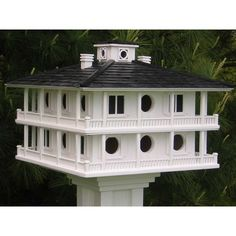 Wooden Purple Martin Houses for $259.95 with Free Shipping! One of the most popular purple martin decorative birdhouses for multiple nesting families.