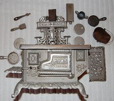 Antique salesmans sample miniature Royal Stove with accessories.