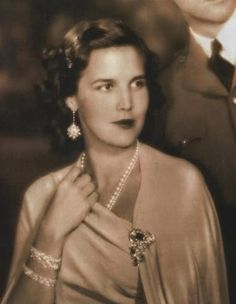 Her Royal Highness Princess Lilian of Belgium, Princess de Réthy. Born Mary Lilian Baels, she became the second wife of King Leopold III in 1941. The couple survived harsh conditions as POWs of the Nazis. They had 2 children and also raised the King's 2 children from his previous marriage.