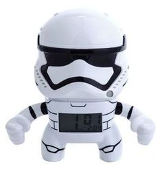 """Star Wars™ 7.5"""" Stormtrooper Alarm Clock. In this Star Wars Stormtrooper Alarm Clock, your aim will never be true as you fight for the First Order. This clock features an LCD display and different alarm settings, making it a great way to rise in a galaxy far away. Runs on two AAA batteries."""