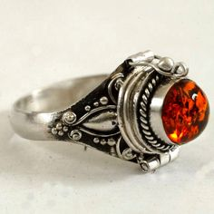 Poison Ring with Orange Amber Stone, Sterling Silver Round Chamber Ring Secret Compartment Ring, Size 5.75 (V3712) by Spoonier on Etsy https://www.etsy.com/listing/228757526/poison-ring-with-orange-amber-stone