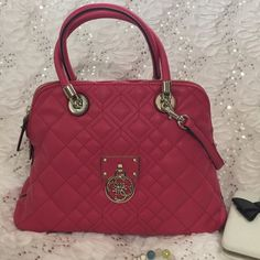 💯% Authentic Guess beautiful Maroon purse!!🌹🌹 This gorgeous Guess purse in maroon with silver accents is one ill be keeping for myself if the price is not right. I had to promise my husband I'd try to sell it on posh and if it didn't sell I was going to keep it for myself. 29 1/2 iches long 6 inches depth and 8 inches wide Guess Bags Shoulder Bags