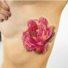 Pink watercolour flower tattoo on side
