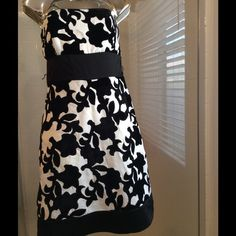SALE  White House/Black Market Dress Strapless cocktail dress with floral appliqué, fitted bodice top, flare skirt bottom, satin waist & hemline, fully lined, invisible zipper. Shell: 100% polyester, Appliqué: 75% rayon, 25% nylon White House Black Market Dresses