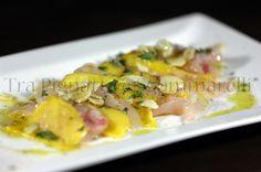 Carpaccio di spigola e mango caramellato agli agrumi, con mandorle sfogliate, emulsione di balsamico e menta