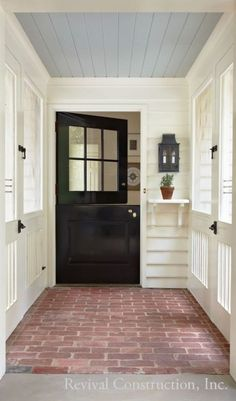 Covered screened porch with black farmhouse style entry door Brick flooring whit. Covered screened porch with black farmhouse style entry door Brick flooring white siding and blue b Modern Farmhouse, Farmhouse Style, Farmhouse Decor, Farmhouse Flooring, Farmhouse Renovation, Modern Porch, Brick Flooring, Penny Flooring, Garage Flooring