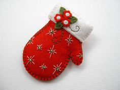 Felt Mitten Pin By Beedeebabee SOLD. Here's a sweet mitten pin, done in wool felt, and measuring just about 2 from it's cuff to it's tip.Felt Mitten Pin -cute idea- Short on time? Available at Etsy shopFelt Mitten Pin - this link is to an Etsy shop, Felt Christmas Decorations, Felt Christmas Ornaments, Christmas Fun, Beaded Ornaments, Handmade Ornaments, Rustic Christmas, Handmade Gifts, Christmas Projects, Felt Crafts