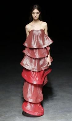 A model presents a creation by Chinese designer Yiqing Yin as part of her Haute Couture Spring-Summer 2014 fashion show in Paris January 22,...