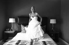 Jumping on the bed in your wedding dress is a must!  So glad @Aaron Snow got this shot.