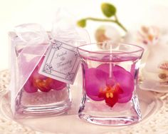 Cute DIY wedding favors!! Candles with an orchid in it!