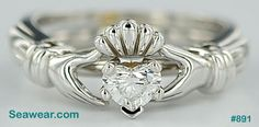 I love this Claddagh ring. It's a claddagh ring enhancer that wraps around a solitare setting. I'm getting one in yellow gold to go with my heart shaped diamond engagement ring! Heart Diamond Engagement Ring, Claddagh Engagement Ring, Diamond Claddagh Ring, Claddagh Rings, Dream Engagement Rings, Diamond Bands, Cute Rings, Pretty Rings, Irish Wedding Rings