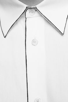 Sketch outline detail on a buttoned shirt // Hermès F/W 2012