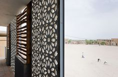 hand-carved stone screens, Ahmed Baba Institute, Timbuktu, Mali : dhk Architects