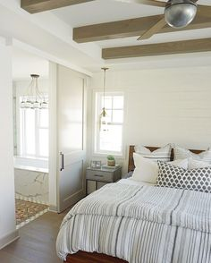Kathryn Miller won us over with her cozy coastal designs, like this gorgeous bright and casual home! It's filled with natural light, modern finishes, and bohemian meets beachy decor. Interior And Exterior, Interior Design, Farmhouse Master Bedroom, Guest Room, Bedrooms, Interiors, Inspiration, Furniture, Barn Doors