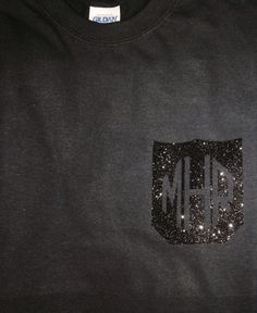 Tone-on-tone glitter pocket tee with monogram.