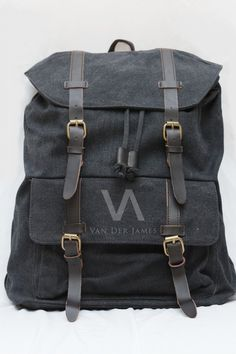 Style: Handbag, Backpack Material: Cow Leather & High Quality Canvas Dimension: P: 35cm, T: 45cm, L: 16cm Processing Surface: Soft Surface Color: Washed Black Structure: Zipper pockets, cell phone bags, document bags, laptop pocket Applicable gender: Male & Female.