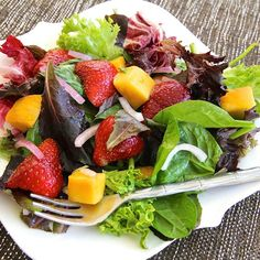 "Strawberry-Mango Mesclun Salad I ""The mix of sweet, salty, and tang from the onion really complimented each other. Everyone wanted the recipe."