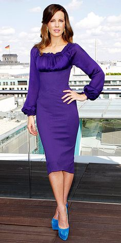KATE BECKINSALE  the actress covers up in a purple long-sleeve Zac Posen frock finished off with blue platforms and a pale pink lip.