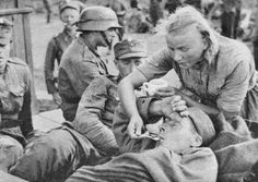 A Finnish Lotta tends to a wounded Finnish soldier during the ongoing Finnish-Soviet Continuation War. August Lotta tends to a wounded Finnish soldier during the ongoing Finnish-Soviet Continuation War. Military Units, Military History, Grimm, Helsinki, Germany Vs, Operation Barbarossa, Man Of War, First Language, German Army