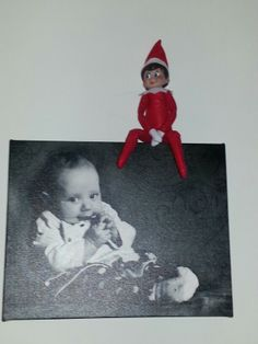 Sitting on a baby picture.