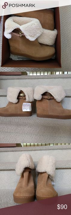 Never been worn Coach Leather Booties Really soft sheep skin booties with a small gold buckle on the side. Faux curly shearing is 100% polyester Coach Shoes Ankle Boots & Booties
