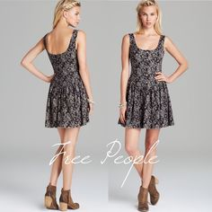 """Free People Ponte de Rome Dress in Expresso Brown Beautiful Free People expresso brown/black paisley skater circle dress, EUC. Pretty detailed buttons, soft fabric, split hem (see last photo) for semi-distressed look. Low cut back (third photo is the back). Size Medium. Flat measurements: waist- 15"""", shoulder to hem- 33"""" Free People Dresses Mini"""