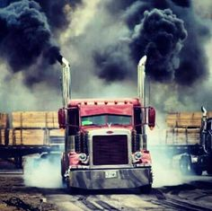 Red Peterbilt rollin' coal and smokin' tires