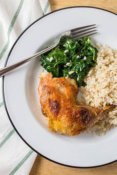 Crispy Chicken Thighs with Garlicky Spinach by thekitchn #Chicken #Spinachh #Garlic