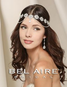 Bel Aire Bridal #6520 Get the  Boho princess look with this rhinestonehalo with draped rhinestone chains.
