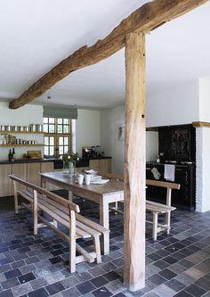 Vintage oven, exposed wood beams, slate floors. Kitchen ideas.