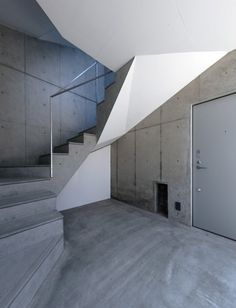 The underside of the stairs are covered in a smooth white render that accentuates their angled edges