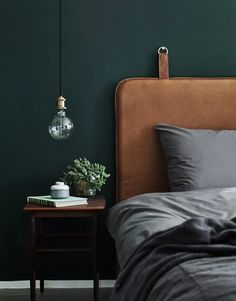leather headboard with dark wall color and lots of texture