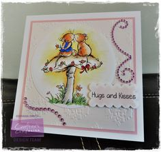 Project by Giovana Smith for Crafter's Companion. Hugs and Kisses Set (Moonbeam Meadow Everyday Collection). Spectrum Noir Markers: Mushroom: IG1, IG3, EB1, EB2, EB3, FS1. Roses: CR4, CR6, CR8 Leaves: DG2, LG2 Ribbon CR8 Grass: LG3, DG2 Lower flowers: OR1 Mice: TN1, TN2, TN3, Bow: CR2, Vest:TB4 Spectrum Noir Blendable Pencil: Sun reflection: 014, 016. Die'sire Circle and Scallop Square dies.