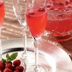Pink Champagne Punch: 1 bottle champagne, 1 2-liter ginger ale, 1 12-oz frozen lemonade concentrate, 11/2 c raspberries.  Mix & serve immediately.