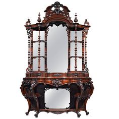 Rococo Revival Rosewood E?tage?re by Thomas Brooks | From a unique collection of antique and modern cabinets at https://www.1stdibs.com/furniture/storage-case-pieces/cabinets/