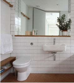 White horizontal wainscotting with the top trim piece stained wood opposed to painted... (for the look like under the mirror)