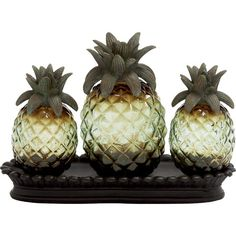 Create a charming display on your foyer console or living room mantel with this gleaming gold-toned pineapple decor, nestled in a black tray.