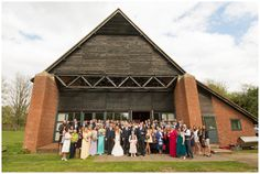 Daytime wedding guests outside New Guesten Hall at Avoncroft Museum of Historic Buildings (avoncroft.org.uk). Rosie Kelly Photography