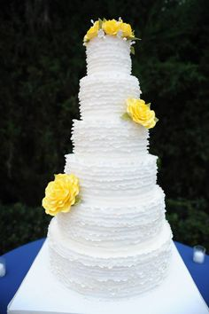 Cypress Grove Estate House: Danielle and Chad  White ruffled wedding cake with yellow sugar flowers by Party Flavors Custom Cakes.