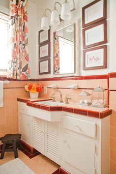 the bathroom has the classic pink and maroon tile original to the house.. looking for ways to decorate with it.