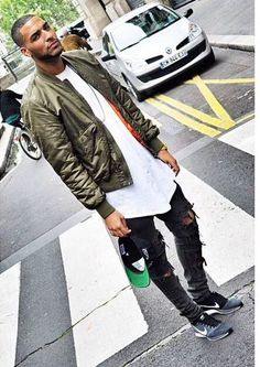 Shop this look on Lookastic:  http://lookastic.com/men/looks/bomber-jacket-crew-neck-t-shirt-skinny-jeans-baseball-cap-athletic-shoes/10517  — Olive Bomber Jacket  — White Crew-neck T-shirt  — Charcoal Ripped Skinny Jeans  — Black Baseball Cap  — Grey Suede Athletic Shoes