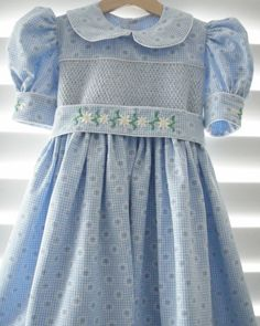Pinner said: This ia a gorgeous size 4 dress. Hand smocked, I have added embroidery to the waist band and cuffs. Little Girl Dresses, Girls Dresses, Punto Smok, Smocked Baby Dresses, Smocked Clothing, Blue Springs, Heirloom Sewing, Smock Dress, Toddler Dress