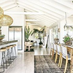 Kitchen and Dining Room. Love the ceilings. I would call this decor bohemian chic. It looks lovely but it needs a bit more character for my taste.